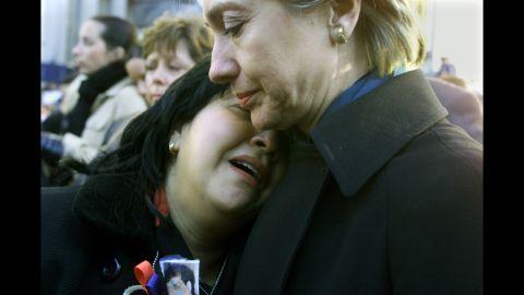 Sen. Clinton comforts Maren Sarkarat, a woman who lost her husband in the September 11 terrorist attacks, during a ground-zero memorial in October 2001.