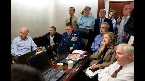 In this photo provided by the White House, Obama, Clinton, Biden and other members of the national security team receive an update on the mission against Osama bin Laden in May 2011.