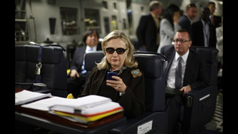 """Clinton checks her Blackberry inside a military plane after leaving Malta in October 2011. In 2015, The New York Times reported that Clinton exclusively used a personal email account during her time as secretary of state. The account, fed through its own server, raises security and preservation concerns. Clinton later said she used a private domain out of """"convenience,"""" but admits in retrospect """"it would have been better"""" to use multiple emails."""