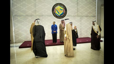 Clinton arrives for a group photo before a forum with the Gulf Cooperation Council in March 2012. The forum was held in Riyadh, Saudi Arabia.