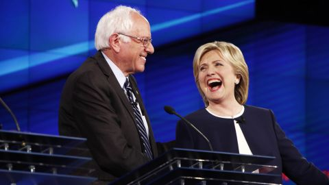 """U.S. Sen. Bernie Sanders shares a lighthearted moment with Clinton during a Democratic presidential debate in October 2015. It came after Sanders gave his take on the Clinton email scandal. """"The American people are sick and tired of hearing about the damn emails,"""" Sanders said. """"Enough of the emails. Let's talk about the real issues facing the United States of America."""""""