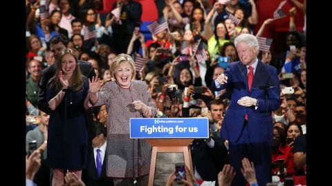 Clinton walks on her stage with her family after winning the New York primary in April.