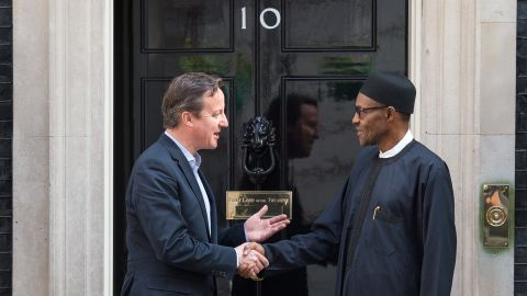 """British Prime Minister David Cameron and Nigeria's President  Muhammadu Buhari shake hands. Cameron recently called Nigeria """"fantastically corrupt"""" in comments before an anti-corruption summit in London."""