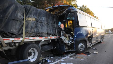 One person died and dozens were injured in the crash.