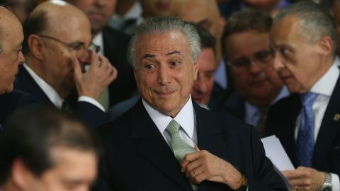 BRASILIA, BRAZIL - MAY 12:  Brazil's interim President Michel Temer (C) attends a swearing in ceremony for new government ministers at the Planalto presidential palace after the Senate voted to accept impeachment charges against suspended President Dilma Rousseff on May 12, 2016 in Brasilia, Brazil. Rousseff has been suspended from her presidential duties and will face a Senate trial for alleged manipulation of government accounts.  (Photo by Mario Tama/Getty Images)