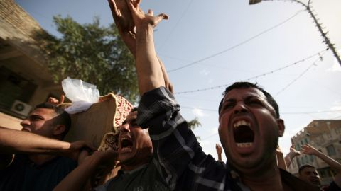 Angry mourners carry the coffin of a victim of an ISIS-claimed suicide attack in the southern Iraqi city of Samawah on May 1.