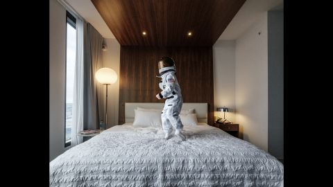 """Sheldon wrote creative captions for each photo that compares his son's experiences to those of real-life astronauts. He called this one, taken at a luxury hotel, """"weightless environment training."""" Sheldon said the hotel was Harrison's favorite place to shoot: """"He keeps asking to go back there and take pictures."""""""