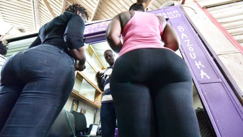 """Women buy bottom enhancer products in a market of Treichville suburb of Abidjan on July 23, 2015. Some like creams, others pop pills or splash out on padded panties. In Ivory Coast where """"big is beautiful"""" bottom enhancers come in all shapes and sorts, and at any cost. / AFP / SIA KAMBOU        (Photo credit should read SIA KAMBOU/AFP/Getty Images)"""