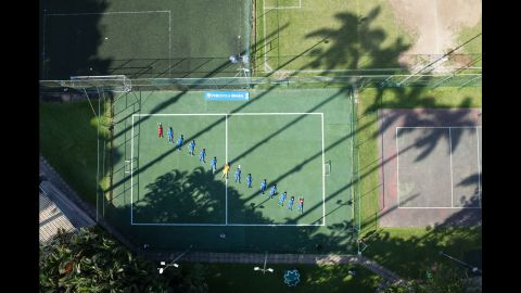 Children lie on a field at the Barcelona Football School in Rio de Janeiro. With 800 young athletes, it is one of the most prestigious sports schools in the city.