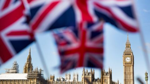 A display of U.K., Union Jack flags fly in front of The Houses of Parliament, in London, U.K., on Monday, Feb. 15, 2016. U.K. lawmakers are not the only ones bracing for a tough few months before Britain's referendum on its European Union membership. A gauge of expected volatility for the pound near the highest since 2011 shows traders are expecting a rough ride too.