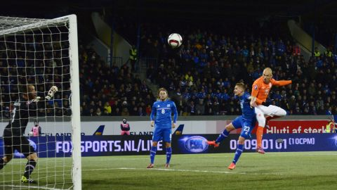 Defender Ari Freyr Skulason battles Dutch forward Arjen Robben. Iceland won both matches against the Netherlands, traditionally one of world football's superpowers. Those defeats contributed to the Dutch missing out on qualification for the tournament in France.