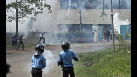 """Police fire tear gas toward opposition supporters as they run away on May 9. """"Having covered the previous protests we were expecting it to end in tear gas and rock-throwing, but not necessarily the kind of violence that we witnessed on Monday,"""" Curtis said."""