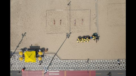 Volleyball is a popular sport on Ipanema's beach.