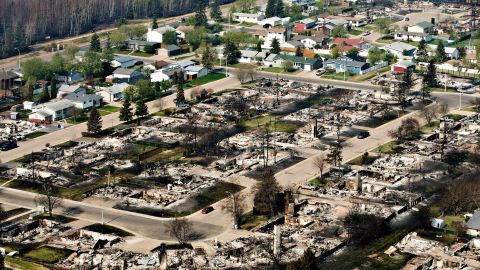 """Remains of burned homes are seen in a neighborhood in Fort McMurray, Alberta, on Friday, May 13. A massive wildfire has <a href=""""http://www.cnn.com/2016/05/08/americas/fort-mcmurray-fire-canada/index.html"""" target=""""_blank"""">forced more than 88,000 people from their homes.</a>"""