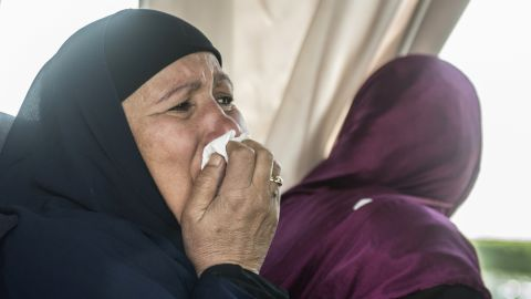 A relative of a passenger who was flying aboard an EgyptAir plane that vanished from radar in route from Paris to Cairo overnight cries as family members are transported by bus to a gathering point at Cairo airport on May 19.