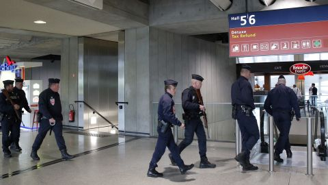 Police officers patrol at Charles de Gaulle airport, outside of Paris, Thursday, May 19, 2016.