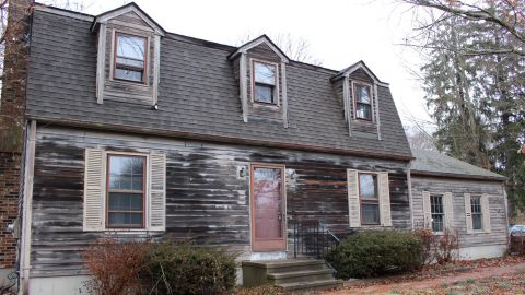BEFORE: Realtor Nicole White and her friend Mike Riccio purchased an old colonial home in January.