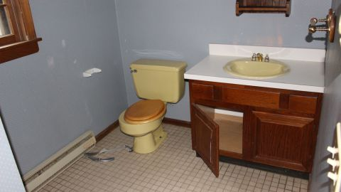 BEFORE: The bathroom showing its age. It took would go through a transformation.