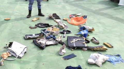 """An imagegrab taken from a video uploaded on the official Facebook page of the Egyptian military spokesperson on May 21, 2016 and taken from an undisclosed location reportedly shows some debris that the search teams found in the sea after the EgyptAir Airbus A320 crashed in the Mediterranean.The Egyptian military spokesman released pictures on his Facebook page of some of the wreckage it recovered so far, including a safety vest and what appeared to be the shredded remains of a seat. EgyptAir flight MS804 sent automated messages signalling smoke onboard before plunging into the Mediterranean, the French aviation safety agency said, as search teams hunted for more wreckage. / AFP PHOTO / Egyptian military spokesperson's facebook page / HO / ===RESTRICTED TO EDITORIAL USE - MANDATORY CREDIT """"AFP PHOTO / Egyptian military spokesperson's Facebook page  - NO MARKETING NO ADVERTISING CAMPAIGNS - DISTRIBUTED AS A SERVICE TO CLIENTS FROM FROM ALTERNATIVE SOURCES, THEREFORE AFP IS NOT RESPONSIBLE FOR ANY DIGITAL ALTERATIONS TO THE PICTURE'S EDITORIAL CONTENT, DATE AND LOCATION WHICH CANNOT BE INDEPENDENTLY VERIFIED == / HO/AFP/Getty Image"""