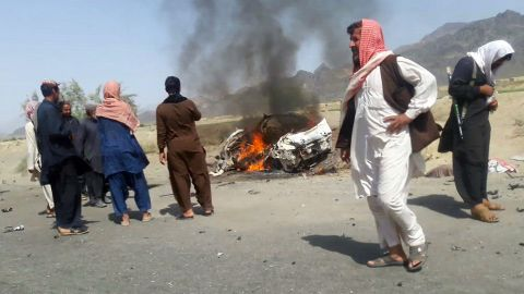 """Residents gather around a destroyed car reportedly hit by a drone strike near the town of Ahmad Wal, Pakistan, on Saturday, May 21. Afghan Taliban leader Mullah Akhtar Mohammad Mansour was believed to be traveling in the vehicle. Sources within al Qaeda and the Taliban, reached through an intermediary by CNN, <a href=""""http://www.cnn.com/2016/05/21/politics/u-s-conducted-airstrike-against-taliban-leader-mullah-mansour/index.html"""">confirmed Mansour's death</a> on Sunday, May 22."""