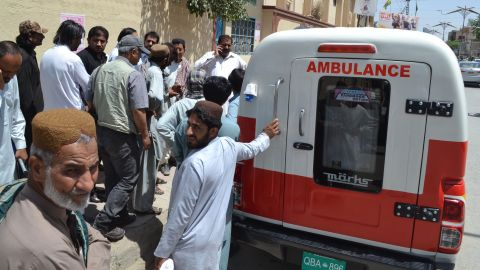 Coffins of two people, one believed to contain the body of the Taliban leader, arrive at the morgue in Quetta, Pakistan, on May 22.