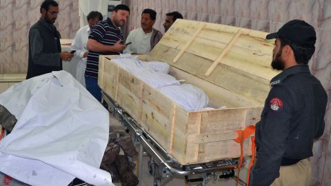 Pakistani security officials and hospital staff oversee two bodies at the Quetta morgue on May 22.