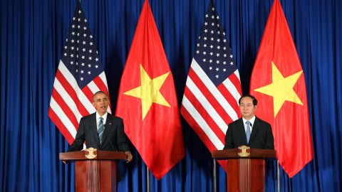 """Vietnam's President Tran Dai Quang (R) and US President Barack Obama (L) take part in a joint press conference at the International Convention Center in Hanoi on May 23, 2016. US President Barack Obama praised """"strengthening ties"""" between the United States and Vietnam at the start of a landmark visit on May 23, as the former wartime foes deepen trade links and share concerns over Chinese actions in disputed seas. / AFP / POOL / LUONG THAI LINH        (Photo credit should read LUONG THAI LINH/AFP/Getty Images)"""