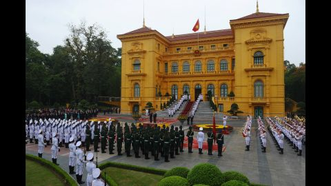 The two Presidents listen to their countries' national anthems during a welcoming ceremony at the Presidential Palace in Hanoi on May 23.