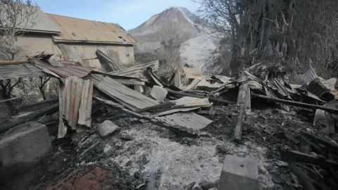 A scorched home is seen on Sunday, May 22, 2016 after it was hit by the eruption of Indonesia's Mount Sinabung. The volcano unleashed hot clouds of ash Saturday, May 21, killing at least seven people in the western province of North Sumatra.