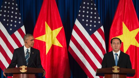 """US President Barack Obama and Vietnamese President Tran Dai Quang speak during a joint press conference in Hanoi on May 23, 2016. Barack Obama praised """"strengthening ties"""" between the United States and Vietnam at the start of a landmark visit May 23, as the former wartime foes deepen trade links and share concerns over Chinese actions in disputed seas. / AFP / JIM WATSON        (Photo credit should read JIM WATSON/AFP/Getty Images)"""