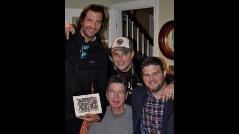 """Former NFL players Rob Tardio, Scott Dragos and Paul Zukaukas presented Horton with the funds they raised for him and his family. """"It was four grown men crying in my living room,"""" said his wife."""