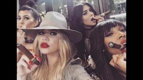"""Television personality Khloe Kardashian, second from left, <a href=""""https://www.instagram.com/p/BFAKLFGBRgY/"""" target=""""_blank"""" target=""""_blank"""">smokes a cigar</a> in this selfie she posted from Cuba on Wednesday, May 4. Joining her, from left, are sisters Kourtney and Kim and friend Malika Haqq."""