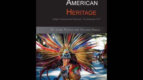 """The cover of  """"Mexican American Heritage"""" features a bare-chested man with an elaborate headdress."""