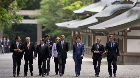 """From left: Italian Prime Minister Matteo Renzi, European Commission President Jean-Claude Juncker, French President François Hollande, Canadian Prime Minister Justin Trudeau, German Chancellor Angela Merkel, U.S. President Barack Obama, Japanese Prime Minister Shinzo Abe, European Council President Donald Tusk and British Prime Minister David Cameron walk past the Kagura-den as they visit Ise Jingu shrine in Ise, Japan, on Thursday, May 26. Obama is visiting Japan and Vietnam <a href=""""http://www.cnn.com/2016/05/23/politics/obama-hiroshima-vietnam-trip-wartime-legacy/index.html"""" target=""""_blank"""">during his 10th trip to Asia.</a>"""
