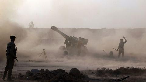 Iraqi Shiite fighters fire artillery near Falluja on May 23.