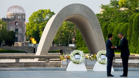 """President Barack Obama and Japanese Prime Minister Shinzo Abe shake hands after laying wreaths at the Hiroshima Peace Memorial Park in Hiroshima on Friday, May 27. <a href=""""http://www.cnn.com/2016/05/27/politics/obama-hiroshima-japan/"""" target=""""_blank"""">Obama, the first sitting president to visit Hiroshima,</a> called for a """"world without nuclear weapons,"""" during his speech but his remarks stopped short of an apology."""
