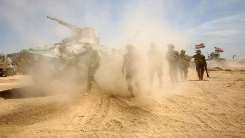Iraqi government forces advance near al-Sejar on May 26.