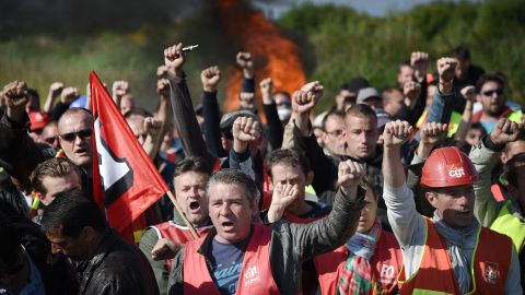 Workers strike and block access to an oil depot near the Total refinery in Donges, western France, on May 27 as the government proposes labor reforms that will tighten workers' rights.