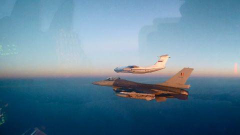 A Belgian F-16 shadows a Russian Il-76.