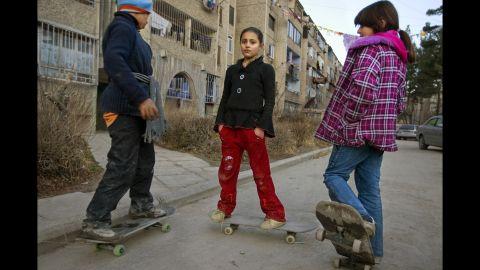 Children skateboard around a middle-class neighborhood in Kabul in January 2009.