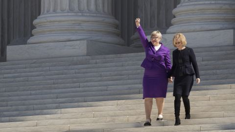 """<strong>Texas abortion law:</strong> Amy Hagstrom Miller, founder and CEO of Whole Woman's Health, gestures to the crowd as she and Nancy Northup, president of the Center for Reproductive Rights, walk down the steps of the Supreme Court in March. They challenged parts of a Texas law -- <a href=""""http://www.cnn.com/2016/06/27/politics/supreme-court-abortion-texas/index.html"""" target=""""_blank"""">struck down by the Supreme Court in June</a> -- that required doctors who perform abortions to have admitting privileges at a nearby hospital. The law also mandated that clinics upgrade their facilities to hospital-like standards. Supporters of the law argued that it was meant to protect women's health, but opponents said it was instead a disguised attempt to end abortion and that women would find it harder to end a pregnancy legally."""