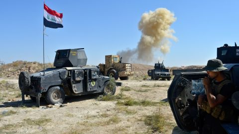 Smoke rises as Iraqi forces face off with ISIS militants on the southern edge of Falluja on Tuesday, May 31.