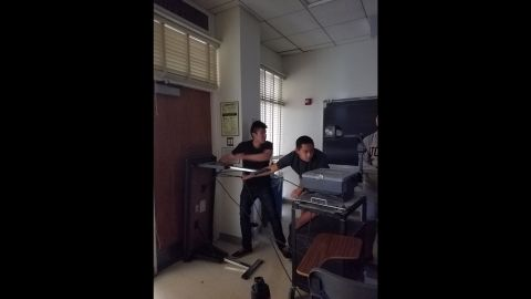 Students barricaded in Bunche Hall at UCLA after hearing a gunshot.