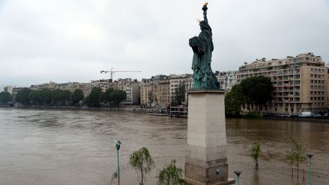 A replica of the Statue of Liberty faces the overflowing Seine in Paris on Wednesday, June 1.