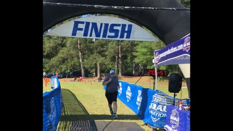 """""""Crossing the finish line at the Tall Pines Sprint Triathlon, some 100 pounds lighter than six months before."""""""