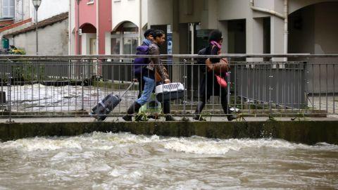 People leave their home in Longjumeau on June 2.