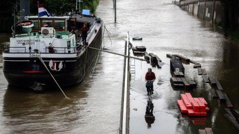 A man rides a bike through a Paris street flooded by the Seine on June 2.