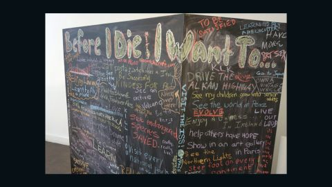 """A chalkboard """"bucket list"""" stirred imaginations and got people talking at an Indianapolis festival designed to help make conversations about death easier. (Jake Harper/WFYI)"""