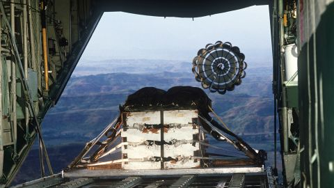 FILE PHOTO: A pallet loaded with heavy cargo is airdropped from a C-130 Hercules aircraft during tactical airdrop training flight for members of the 345th Tactical Airlift Squadron. Eight air crews and two aircraft are deployed from Yokota Air Base, Japan, to Clark Air Base for the exercise. (Photo by USAF)