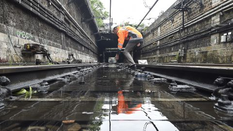 """A technician assesses flood damage on railway  tracks in Paris on Saturday, June 4. <a href=""""http://www.cnn.com/2016/06/04/europe/france-germany-floods/index.html"""" target=""""_blank"""">The rain-swollen Seine river receded Saturday for the first time in a week after nearing its highest level in three decades. </a>"""